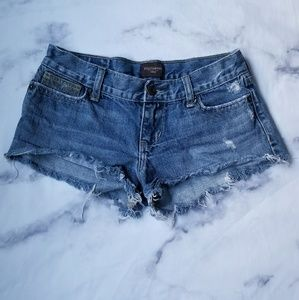 Hollister light distressed mid-rise jean shorts